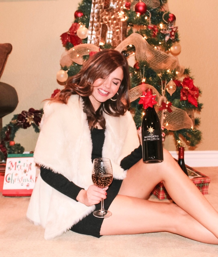 Faux shearling vest, glass of wine, roscato wine, christmas tree, presents, black dress, holiday outfit